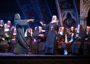 "Sinead Coll as Sister Mary Patrick in ""Sister Act"" with Jean Michelo as Dolores Van Cartier and the Belfast Operatic Company chorus."